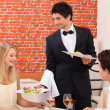 Waiter serving plate of food — Stock Photo #10021704