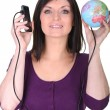 Woman with her phone connected to the world - Stockfoto