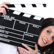 Woman holding a clapper board — Stock Photo