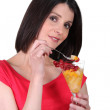 Brunette eating delicious fruit salad — Stock Photo #10022755