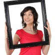 Stock Photo: Womholding wooden frame