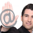 Stock Photo: Handsome mwith sign