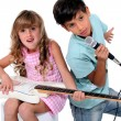 Kids pretending to be in a rock band — Stock Photo #10023744