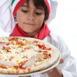 Stock Photo: Young boy pretending to be pizzmaker