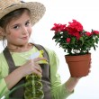 Little girl watering plant — Stock Photo