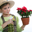 Little girl watering plant - Foto Stock