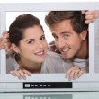 Stock Photo: Couple in television screen