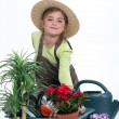 Stock Photo: Child pretending to be florist