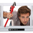Plumber coming out of the television — Stock Photo #10024473