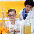 Kids conducting an experiment on oranges - Stok fotoraf