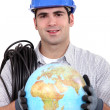 Electrician holding a globe. — Stock Photo