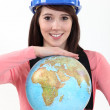 Female apprentice holding globe — Stock Photo #10025182