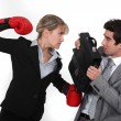Stock Photo: Businessmwith boxing gloves hitting man