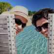 Father and son sat poolside — Stock Photo #10025479