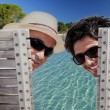 Father and son sat poolside — Stock Photo