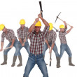 Stock Photo: Photo-montage of a laborer using pickaxe