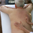 Senior man receiving a back massage — Stock Photo #10026237