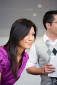 Asian businesswoman meeting customer — Stock Photo