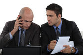 Business professionals dealing with a problem — Stock Photo