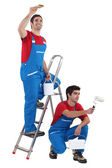 Two painter working on the same house — Stock Photo