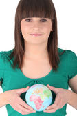 Brown-haired girl holding globe — Stock Photo