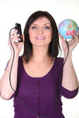 Woman with her phone connected to the world — Stock Photo