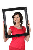 A woman holding a wooden frame — Stock Photo