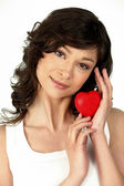 Brunette woman with heart in hand — Stock Photo