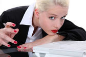 Bored blond receptionist — Stok fotoğraf