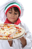 Young boy pretending to a be a pizza maker — Stock Photo