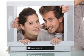 Couple in a television screen — Stock Photo