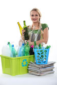 Blond woman recycling — Stock Photo