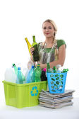 Bottles and paper recycling — Stock Photo