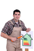 Man with an energy rating symbol — Stock Photo