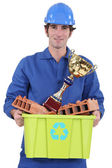 Builder with an award for recycling material — Stock Photo