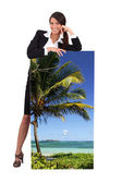 Agent with a poster of a tropical beach — Stock Photo