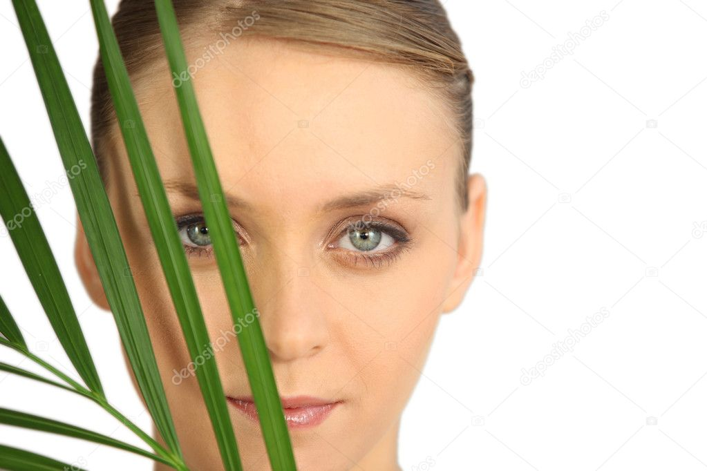 Woman hiding behind a fern  Stock Photo #10026228