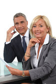 Senior business couple going over contract — Stock Photo