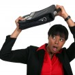 Woman protecting her head with a suitcase — Stock Photo #10083072