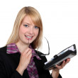 Female office worker with a diary — Stock Photo #10083342