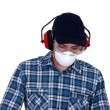 Craftsman wearing protection mask, earphones and glasses - Stock Photo