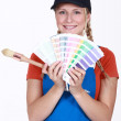 Painter holding a selection of colour samples — Stock Photo #10085581