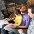 Young family watching film on laptop — Stock Photo