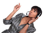 A African American businesswoman with a headset on. — Stock Photo