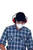 Craftsman wearing protection mask, earphones and glasses — Stock Photo