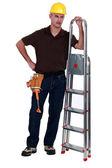 Haughty tradesman posing with a stepladder — Stock Photo