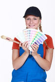 Painter holding a selection of colour samples — Stock Photo