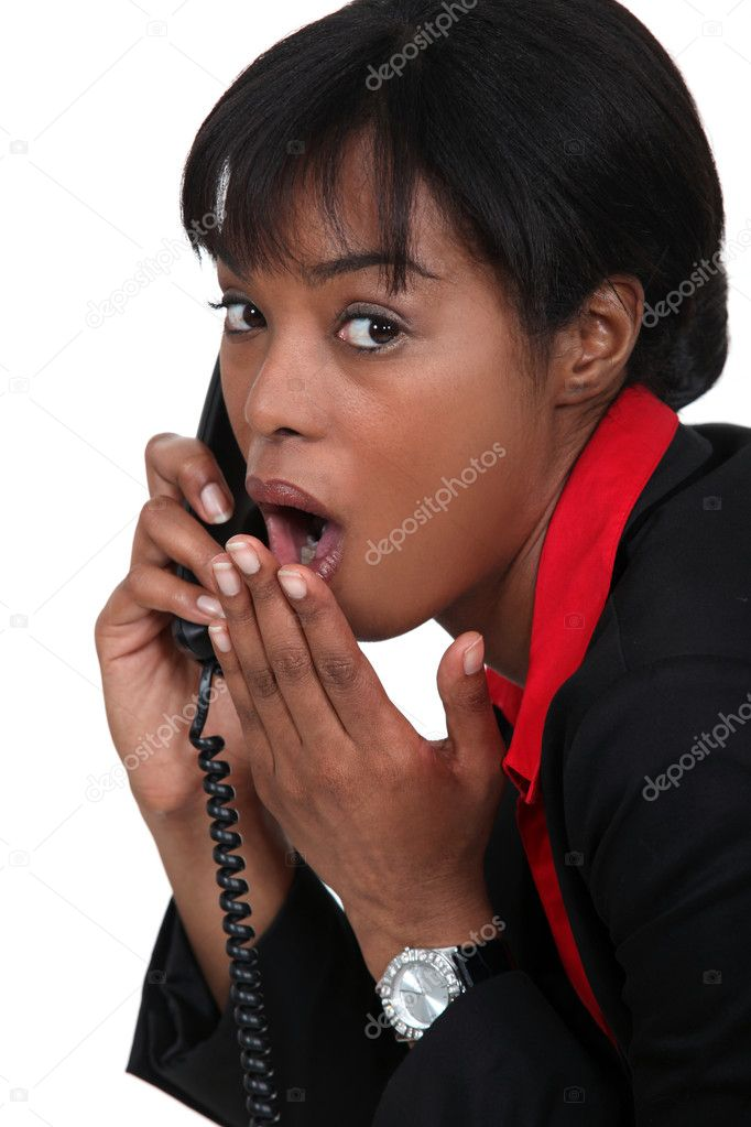 Black businesswoman on the phone  shocked at sensational news  Stock Photo #10083140