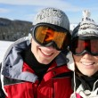 Skiing couple laying in the snow - Foto Stock