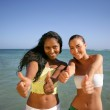 Two girlfriends having fun on the beach — Stock Photo